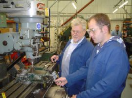 David Franks explains milling machine to Peter Pollard